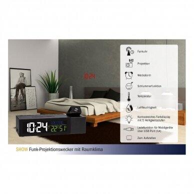 Radijo bangomis valdomas projekcinis žadintuvas su vidaus termometru-higrometru bei išmaniojo telefono pakrovėju TFA SHOW 4